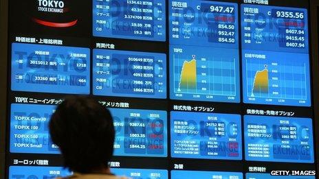 Tokyo stock exchange screens