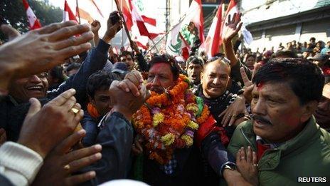 Supporters congratulate Rajan K.C., candidate of party Nepali Congress, after he defeated Nepal Maoist leader Pushpa Kamal Dahal in Kathmandu November 21, 2013
