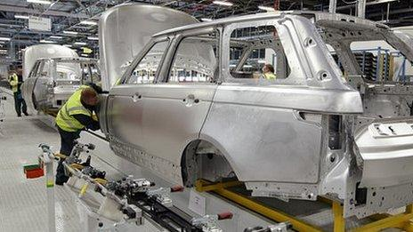 Range Rover car bodies and workers at Jaguar Land Rover, Solihull, UK