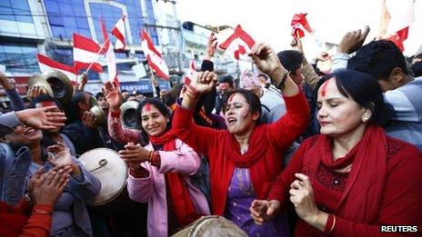 Supporters of Nepali Congress Party cheer for their party