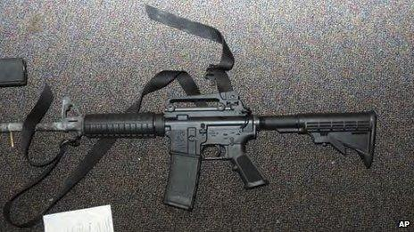 Image from report of the Sandy Hook Elementary School shooting in Newtown, Connecticut shows a gun found in the school, released 25 November 2013