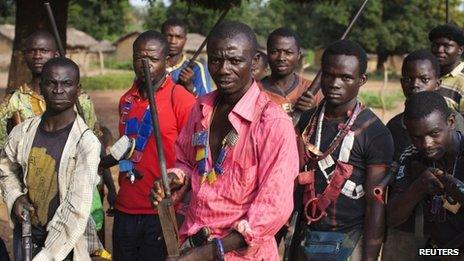 Militia fighters known as anti-balaka pose for a photograph in Mbakate village, Central African Republic November 25, 2013. The group say they are protecting their village from Seleka fighters.