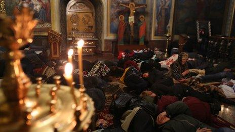 Protesters sleep at Kiev's St Michael Cathedral