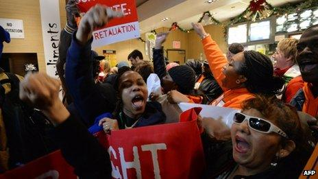 Demonstrators inside a McDonald's near New York's Times Square on 5 December 2013