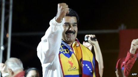 Venezuelan President Nicolas Maduro gives a speech after the first official results in the municipal elections were announced in Caracas on 8 December, 2013