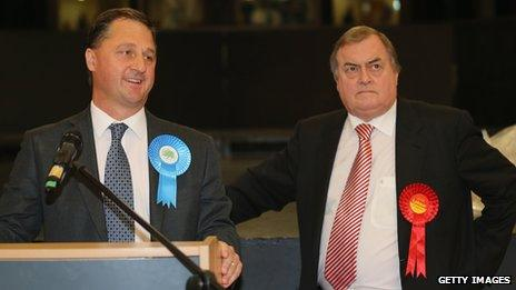 The newly elected Humberside Police and Crime Commissioner Matthew Grove (L) makes his victory speech as runner-up former deputy prime minister Lord Prescott looks on