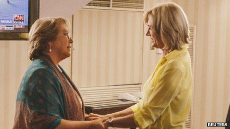 Evelyn Matthei (right) greets president-elect Michelle Bachelet after conceding defeat in the second round of the presidential election on 15 December, 2013