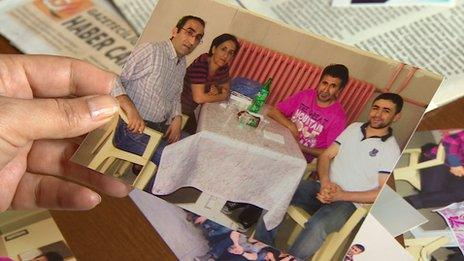 Dilsah Deniz shows a photo of her visit to her imprisoned brother Huseyin