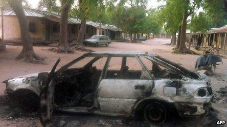 A vehicle burnt by the Islamist group Boko Haram in the north-eastern town of Bama - 7 May 2013