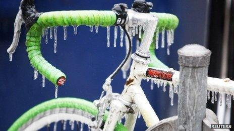 A bicycle is covered with ice after freezing rain in Toronto