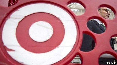 US Senator Charles Schumer, is pictured through a Target shopping cart, as he holds a news conference about the massive credit card hack that has affected 40 million Target customers 22 December 2013