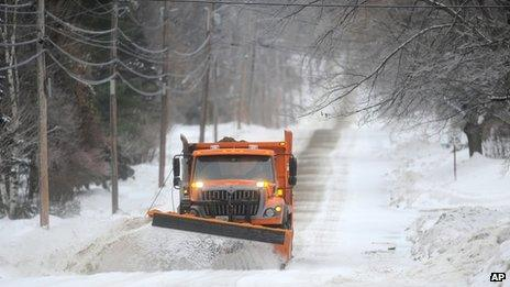 A snowplow clears a road in Waterville, Maine