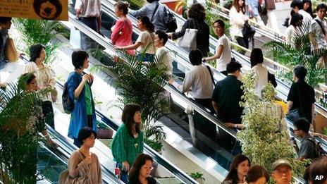 File photos of shoppers in Yokohama, near Tokyo