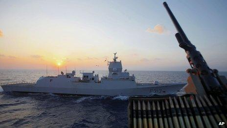 The Norwegian warship Helge Ingstad passes by the Danish warship Esbern Snare at sea between Cyprus and Syria (5 January 2014)