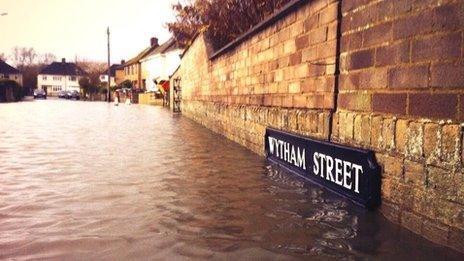 Rising flood water at Wytham Street