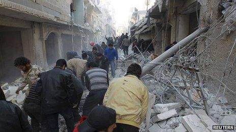 Search for survivors after air strike in Aleppo. 28 Dec 2013