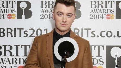 Sam Smith with his Brit Award