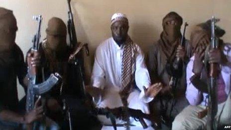A screen grab allegedly showing Boko Haram leader Abubakar Shekau (C) flanked by militants