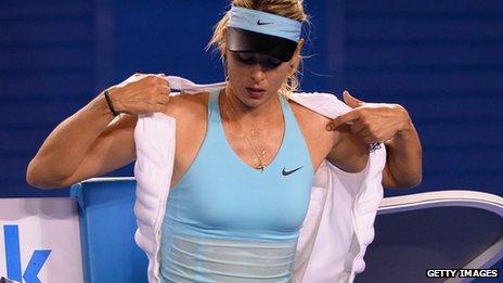 Maria Sharapova puts on an ice vest