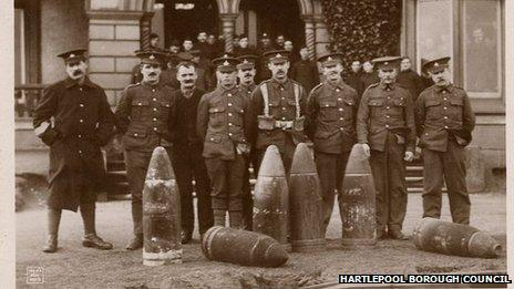 soldiers posing with defused shells outside of a hotel in Seaton Carew