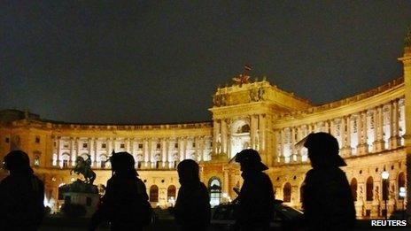 Police wearing riot gear walk in front of Hofburg palace during Austrian Freedom Party