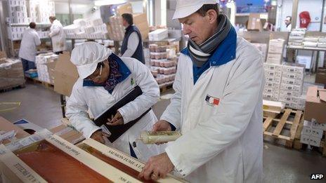 Inspectors of veterinary services and fraud inspect seafood products at the Rungis international market in Rungis, near Paris.