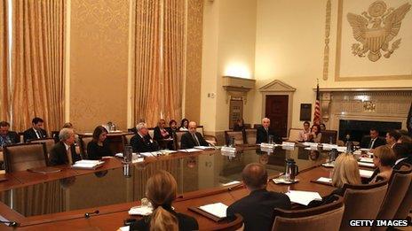 Ben Bernanke sitting at FOMC table in Fed