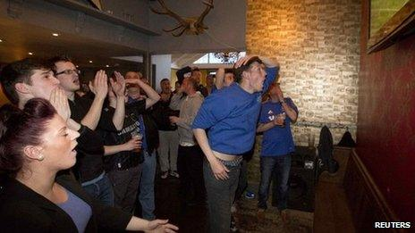 Chelsea fans watching football on a pub TV