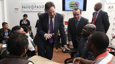 Britain's Deputy Prime Minister Nick Clegg talks with former guerrillas during a visit at a reintegration centre in Bogota