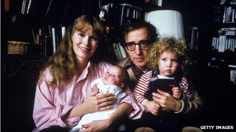 Mia Farrow, Woody Allen, Satchel and Dylan in a portrait taken in 1988