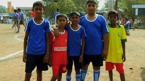Football hopefuls. Slum kids in football strip