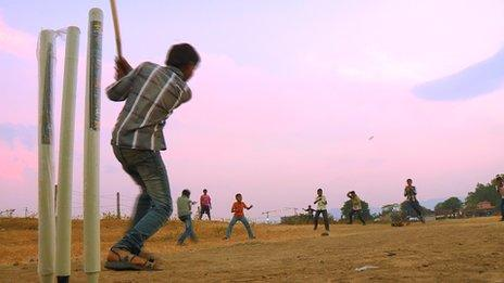 Kids playing cricket in India