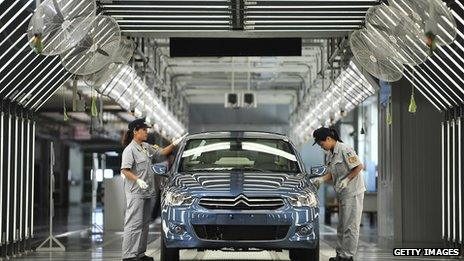 Workers on the production line in a new plant of Dongfeng Peugeot-Citroën Automobile in China