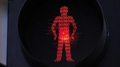 A close-up of red-man don't walk sign.