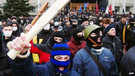 Pro-Russian activists wave clubs as they react after an unsuccessful attempt to storm a regional state administration building in the Black Sea city of Odessa on 3 March 2014