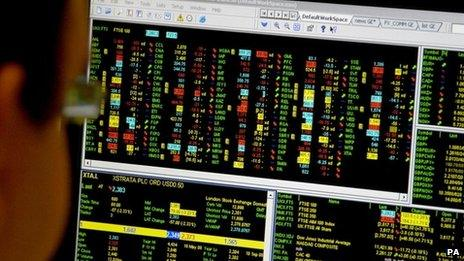 Man looking at trading screen