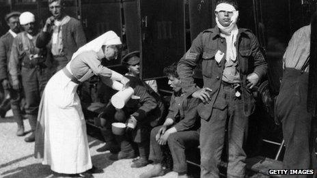 A nurse treating soldiers in France