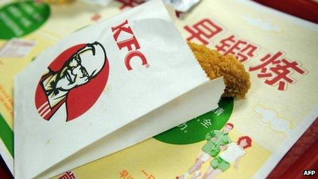 A KFC bag containing a chicken wing
