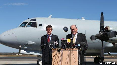 Australian Air Chief Marshal Angus Houston and Defence Minister David Johnston address the media during a press conference at Pearce airforce base in Perth