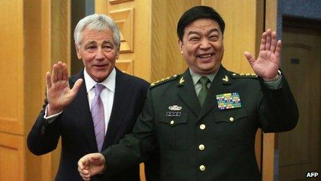 US Defense Secretary Chuck Hagel (L) and Chinese Minister of Defense Chang Wanquan gesture to members of the media prior to their meeting at the Chinese Defense Ministry headquarters in Beijing on April 8, 2014.