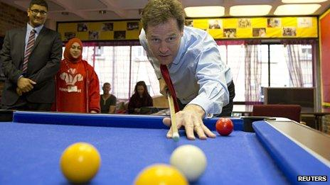 Nick Clegg playing pool during a visit to St Andrews Youth Club in central London