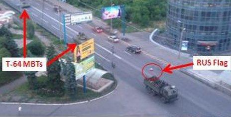 Alleged T-65 is shown in Makiiva, next to a lorry with a Russian flag