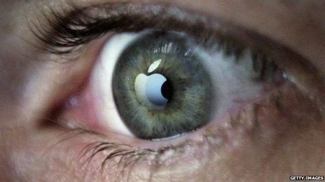 Apple logo reflected in eye