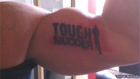 A Tough Mudder tattoo on a man's arm