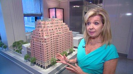 Nikki Field, estate agent, in front of model of Carlton House flat complex