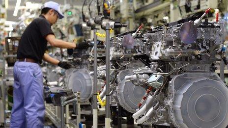 An employee of Toyota Motor's subsidiary Toyota Motor Kyushu at the Kanda Plant in Kanda, Fukuoka Prefecture, on August 7, 2014