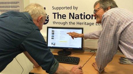 Volunteers Alan Renton (right) Kenn Shearer working on the online facility