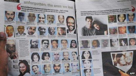 A man reads a newspaper with portraits of Westgate mall victims on 19 September 2014