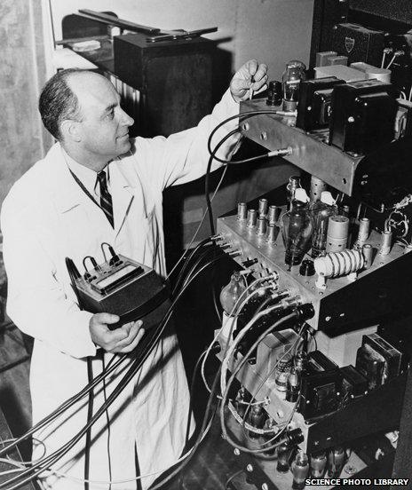 Enrico Fermi with electronic equipment for the University of Chicago's particle accelerator