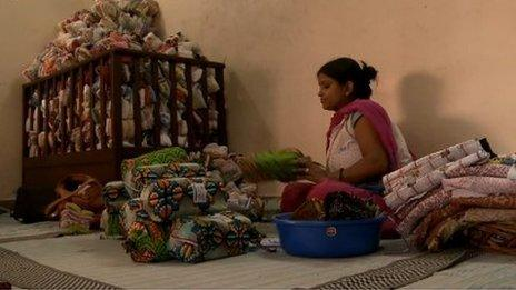 Women making sanitary towels in India from recycled cloths